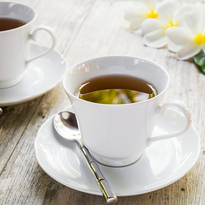 two cups filled with tea on a table