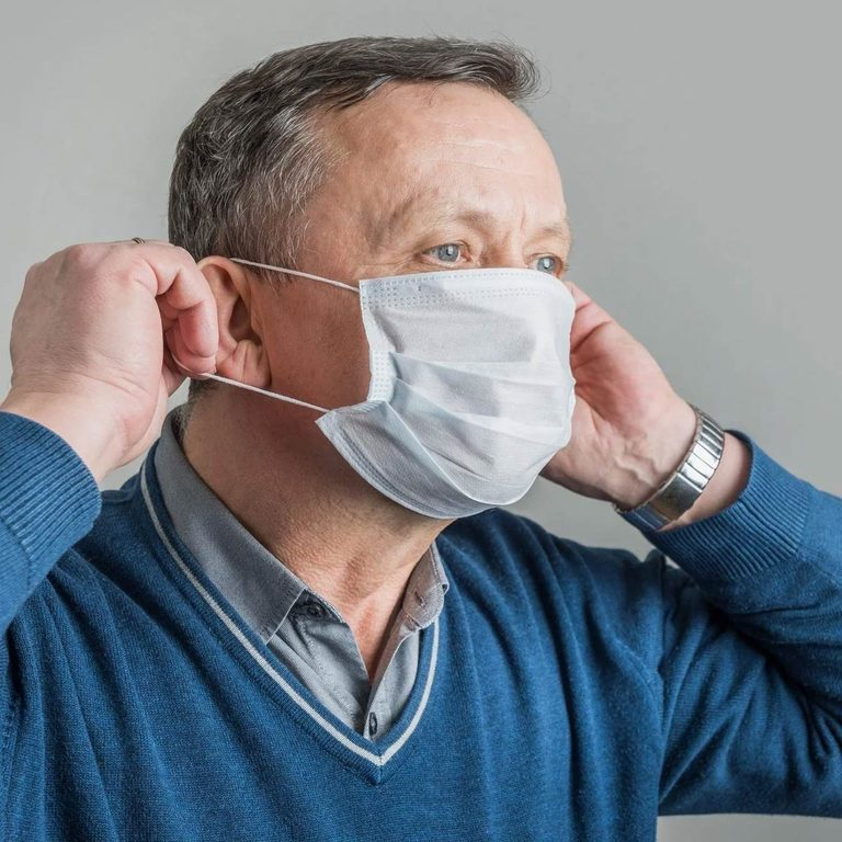 Adult Man Puts On Surgical Mask To Protect Against Virus Covid 19 Prevention Of Coronavirus Gettyimages 1218543636 E1612369328358
