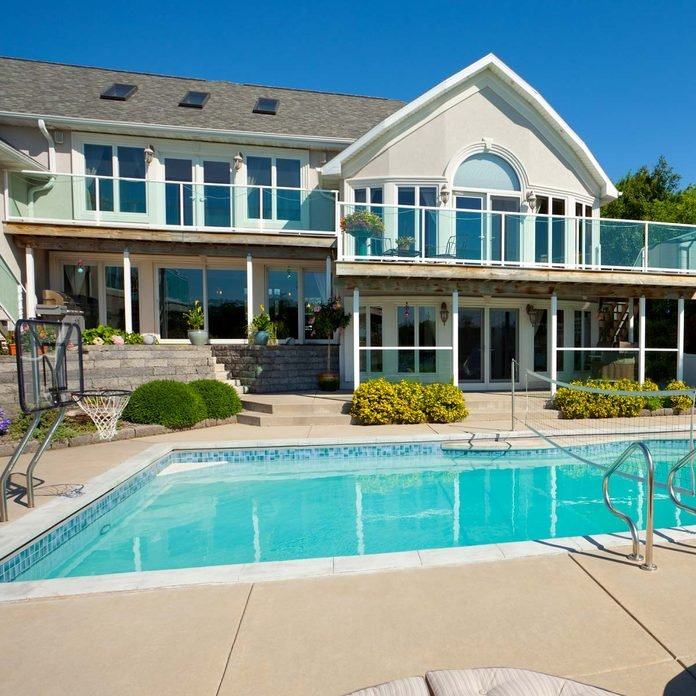 Idyllic Mansion House With In-Ground Swimming Pool and Patio Deck basketball hoop Gettyimages 184350675 Hoop