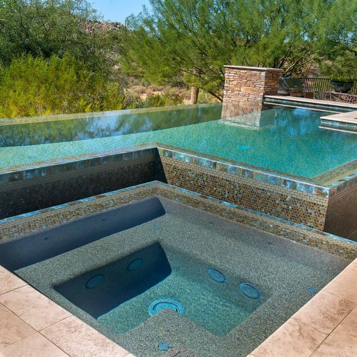 modern swimming pool with hottubGettyimages 186412362 Hottub