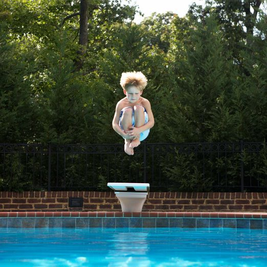 Boy (5-7) jumping into pool diving boardGettyimages 200490282 006 Diving Board