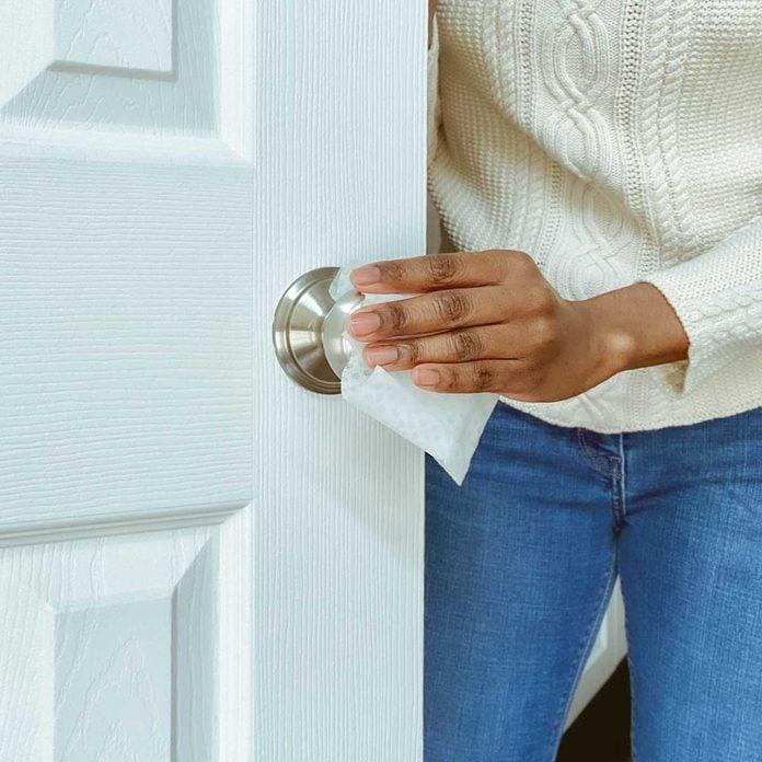 Cleaning Door Knob Gettyimages 1211844309