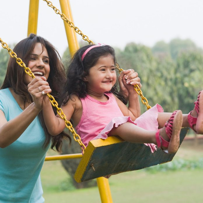 Family Using A Swing Set Gettyimages 140826705