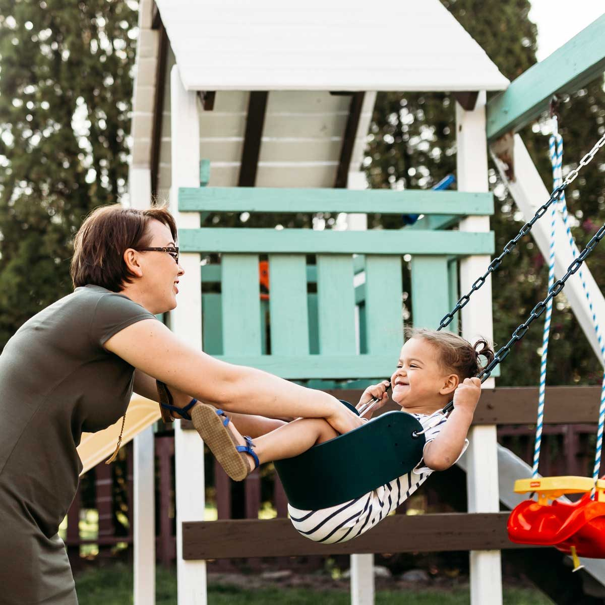 Playing On Swing Set Gettyimages 961332858