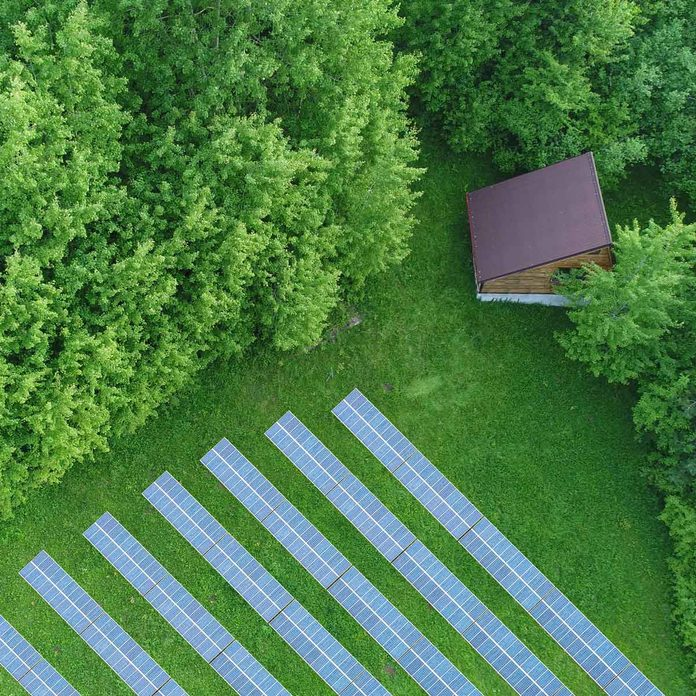 Cabin Field With Solar Panels Gettyimages 1299971943