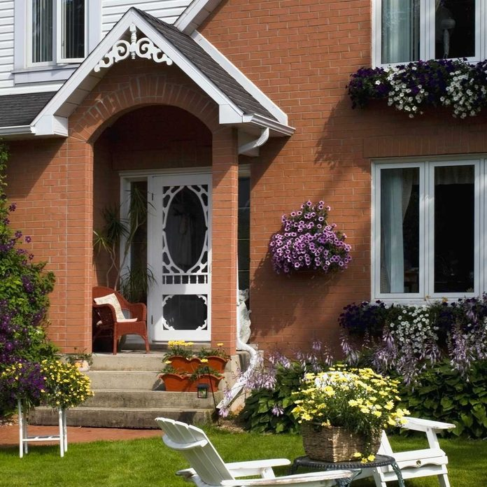 House with window boxes, wall-mounted boxes and front step flower boxes