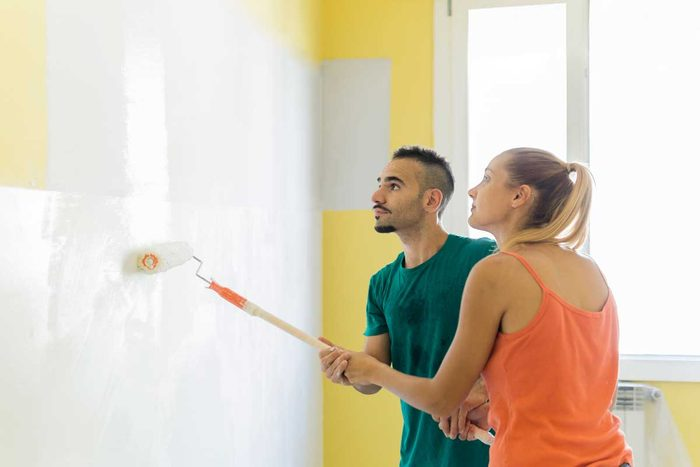 Couple Painting A House