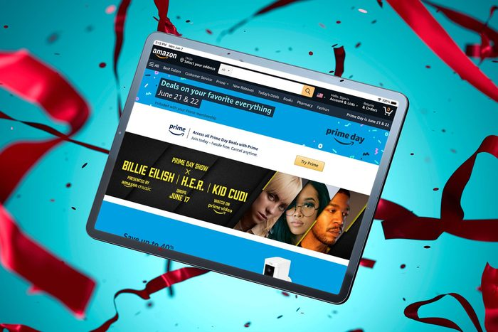 amazon.com primeday screen shown on a table floating amont confetti and ribbon with a blue background