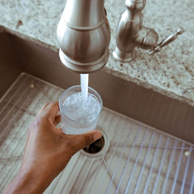 Filling up a glass of water