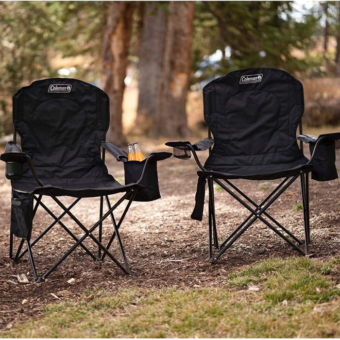 two coleman camping chairs in the woods