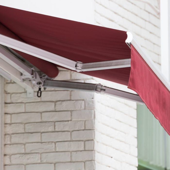 red manual roll out patio awning