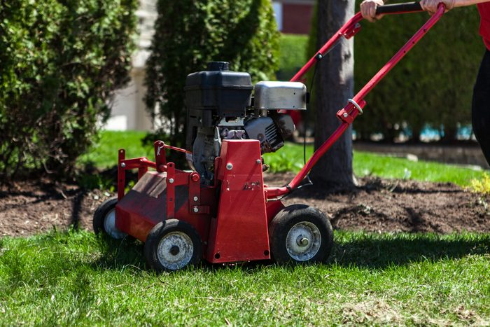 Lawn aerator being used in a suburban environment