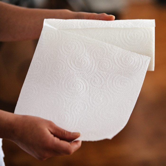 Ripping a paper towel off the roll