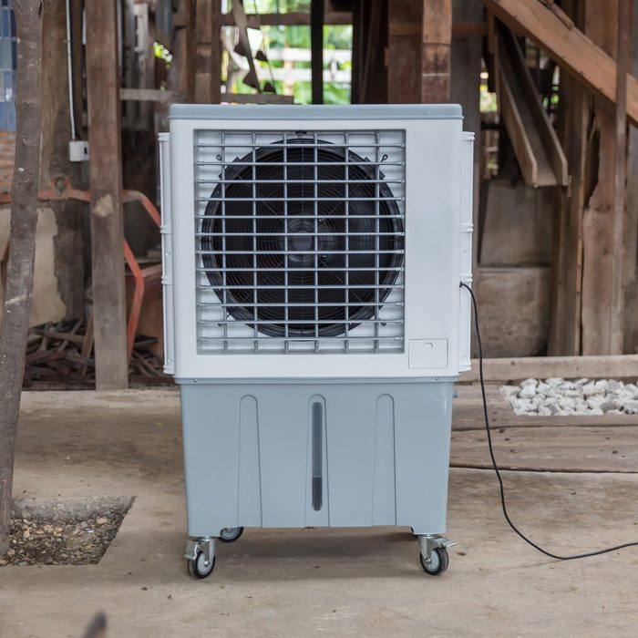 Evaporative Air Cooling Fan. Air Conditioning. Portable Air Cooler And Humidifier On Casters. Mobile Air Purifier.