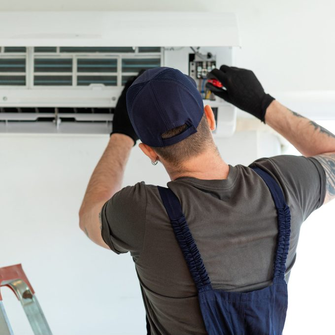 Technician repairing air conditioner
