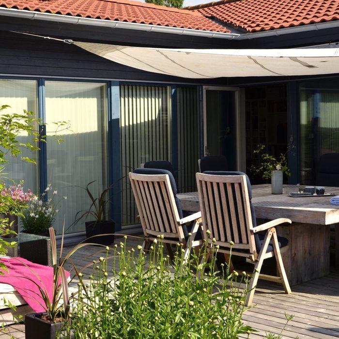 backyard patio with sun shade sail