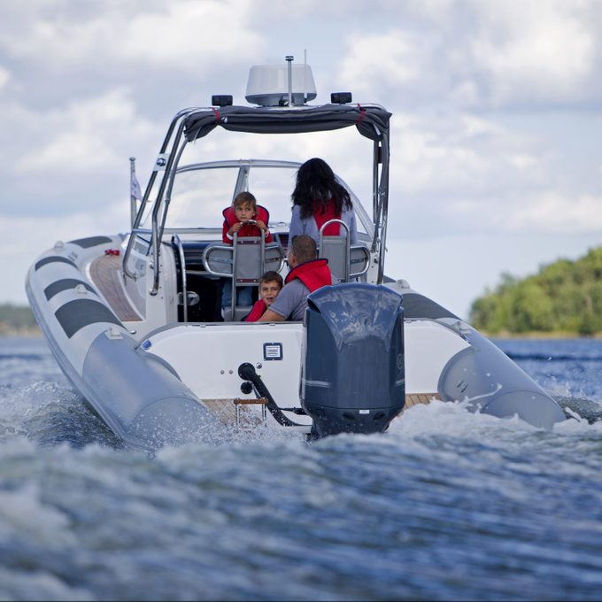 Family in a used motorboat