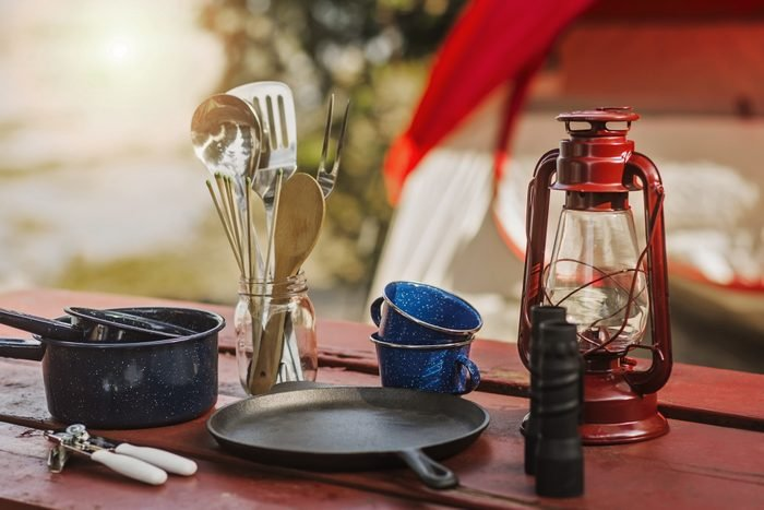 camping utensils and cutlery on picnic table