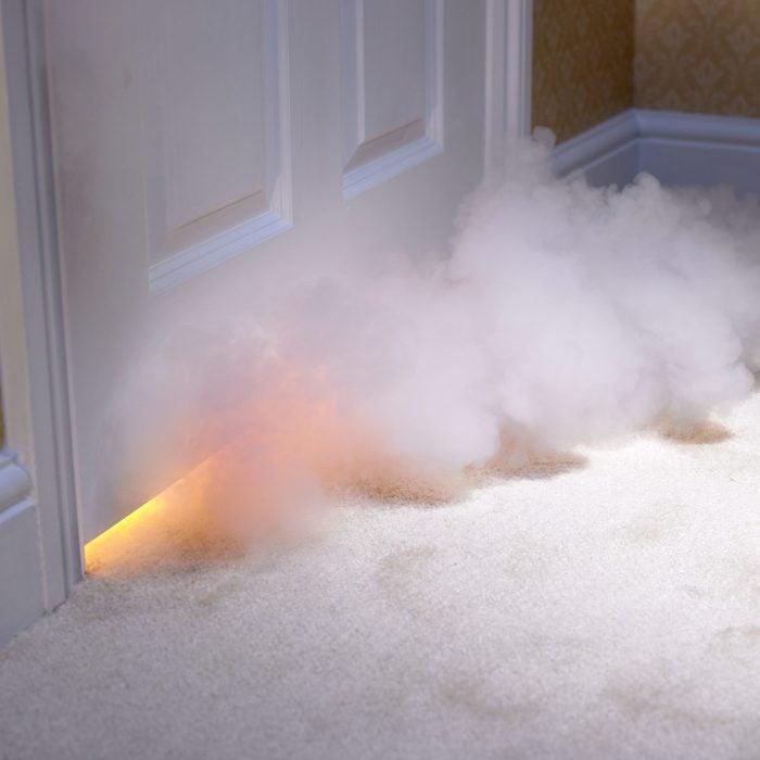 Smoke coming in under door in home