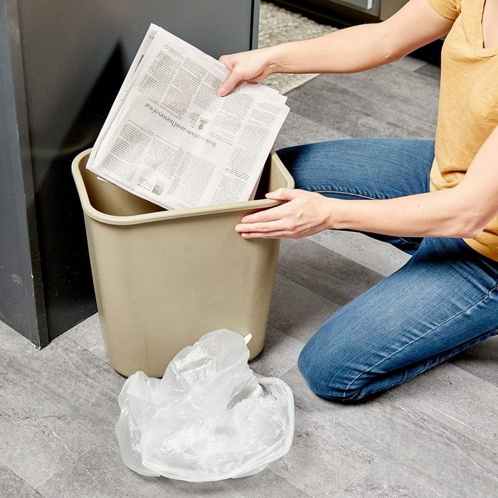 Newspaper In Garbage Can