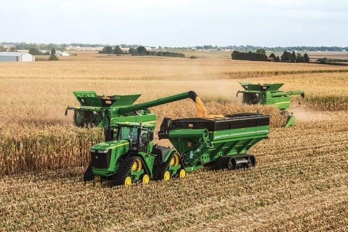John Deere farm equipment in a corn field