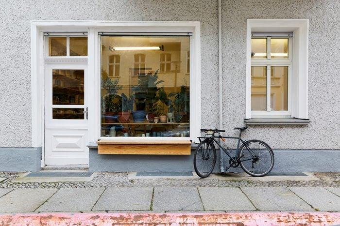 bike parked outside of an art studio