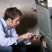 Homeowner repairing furnace