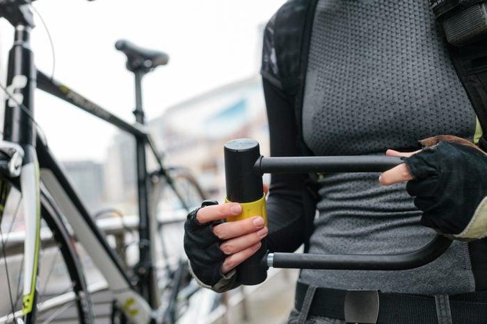 Woman holding Bicycle Lock
