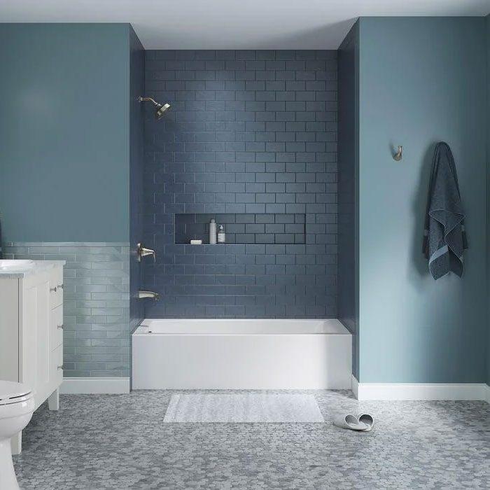 Kohler Elmbrook Alcove Bathtub in white in a modern blue bathroom