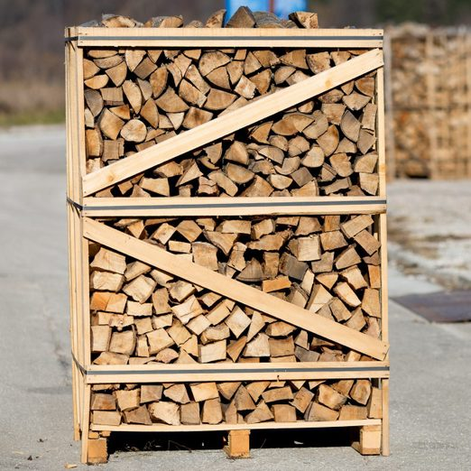 Wood pallet filled with firewood. Firewood ready for the winter season