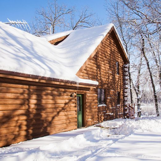 Cabin in snow covered forest