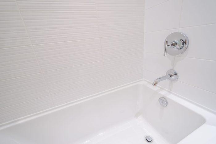 standard white bathtub in bathroom