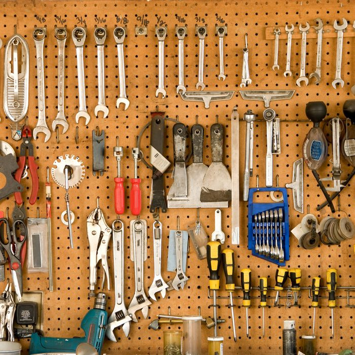 tools hanging on pegboard in garage