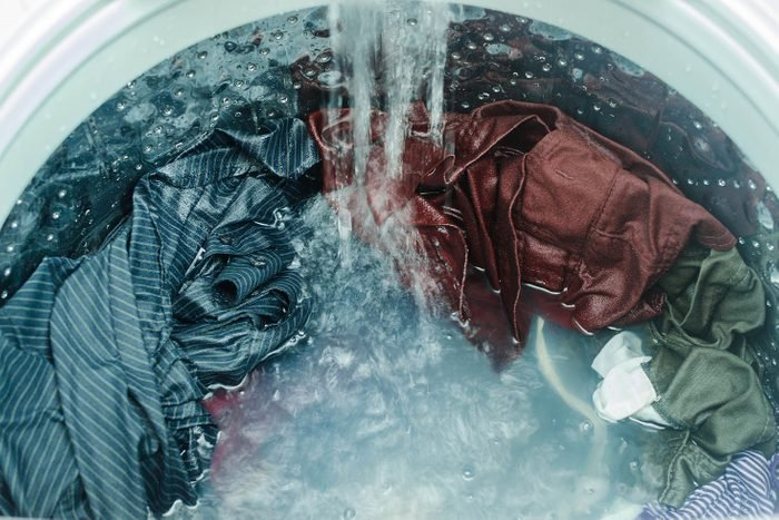 High Angle View Of Clothes Being Washed In Washing Machine